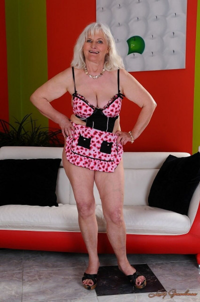 Blonde granny Judi strips her clothes and shows her tits and ass